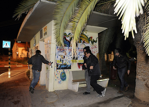 Sderot residents running for cover, Wednesday (Photo: AFP)