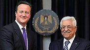 Cameron and Abbas during a press conference in Bethlehem. Photo: Reuters