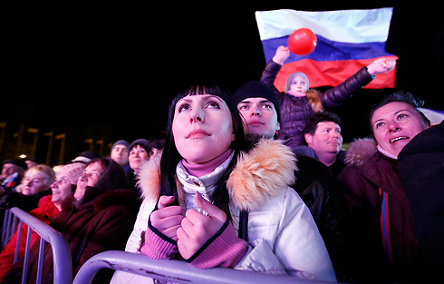 Celebrations in Lenin Square in Simferopol after referendum exit polls show majority in favor of rejoining Russia. (Photo: Reuters)