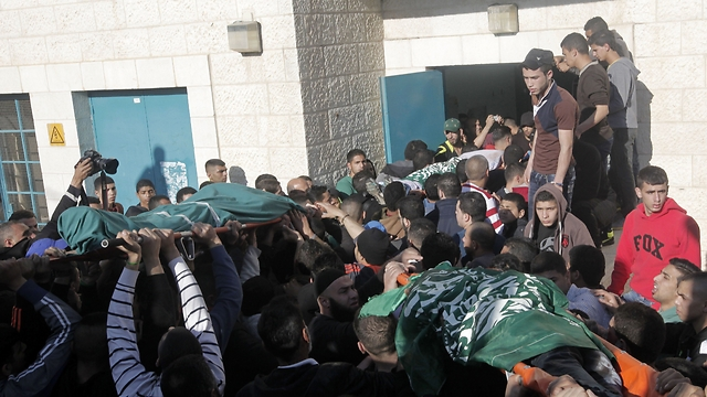 Bodies of three Palestinians killed in the operation (Photo: AFP)