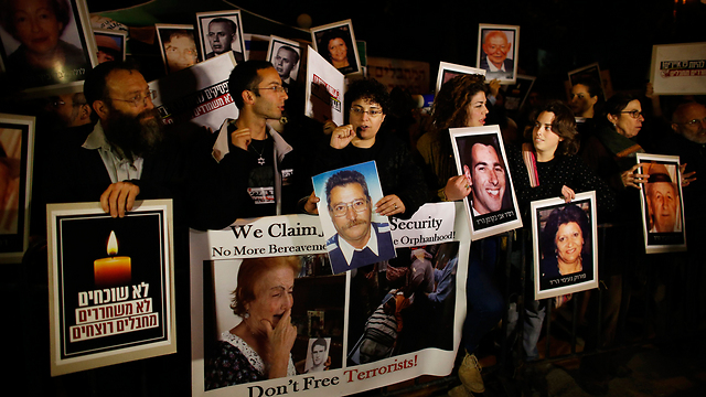 Families of terror victims at protest, last week. (Photo: Reuters)