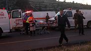 Ambulances after fatal shooting attack near Hebron Photo: EPA