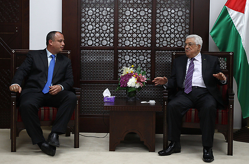Abbas with MK Hilik Bar (Labor) (Photo: AFP)