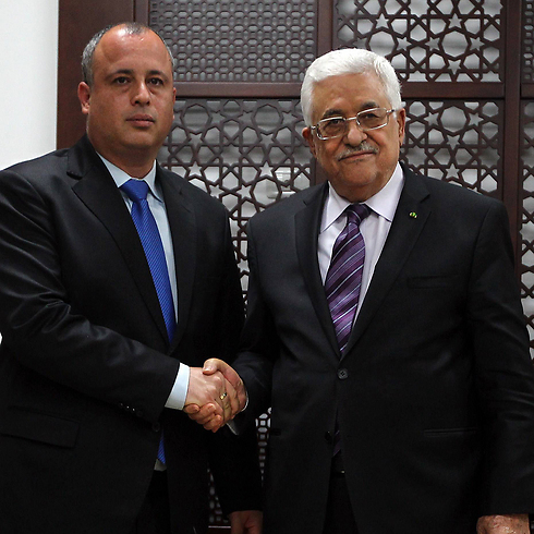 Abbas with Labor MK Yehiel (Hilik) Bar (Photo: AFP)