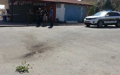 Rocket hits road in residential area of Sderot (Photo: Roee Idan)