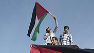 Palestinians in Gaza celebrate the unity agreement between Fatah and Hamas (Photo: AFP)
