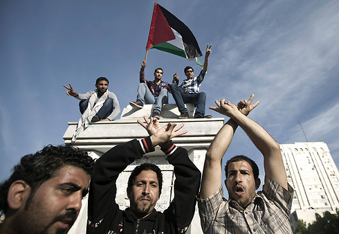 Palestinians in Gaza celebrating the unity accords (Photo: AFP)