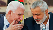 Fatah, Hamas at signing of reconciliation agreement Photo: Reuters
