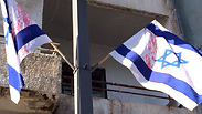 Defaced flags in Jaffa Photo: Tel Aviv District Police