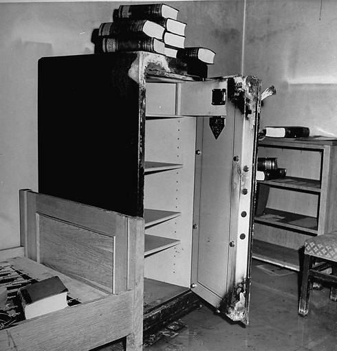 A pile of books over a safe that was broken open (Photo: GettyImages)