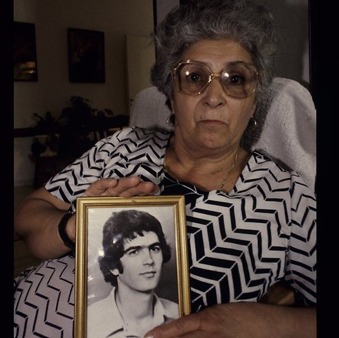 Tayeb's mother Shoshana with his picture. (Photo: Amikam Horesh) (Photo: Amikam Horesh)