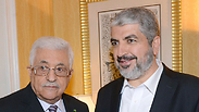 Abbas with Hamas' Khaled Mashaal Photo: Reuters