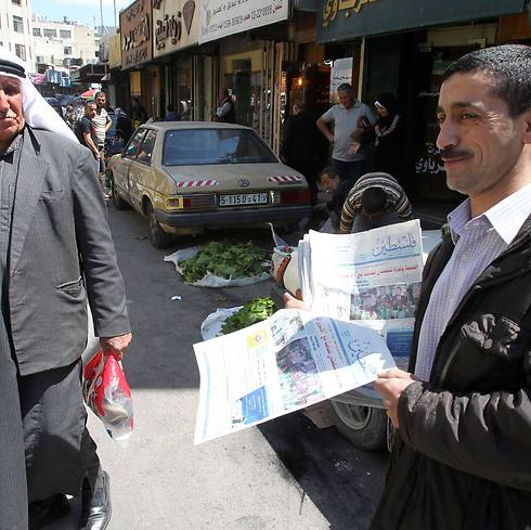 A Palestinian sells issues of the Hamas-affiliated newspaper Falesteen in Hebron (Photo: AFP) Photo: AFP