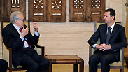 Brahimi with Bashar Assad Photo: AP