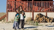Moriyah with her children outside their home in Ma'ale Rehavam, before the demolition operation Photo: Avital Hirsch