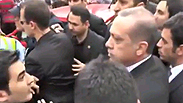 Did Erdogan slap a protester?