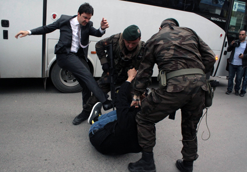 Yusuf Yerkel caught on camera kicking a protester (Photo: AP)