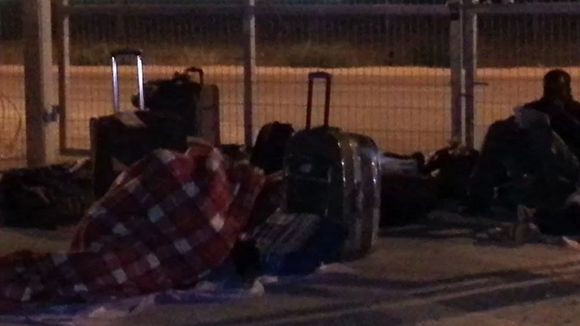 An asylum seeker sleeping outdoors at Holot after no bed was found for him. (Photo: Anwar)