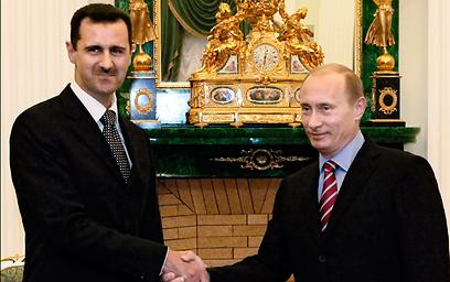 Assad with Russian President Putin (Photo: AP)