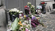 Flowers outside Jewish museum in Brussels. 'It was only a matter of time' Photo: AFP