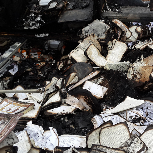 Holy books that were set on fire (Photo: Hassan Shaalan) Photo: Hassan Shaalan