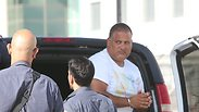 Union boss Alon Hassan being taken for questioning Photo: Shaul Golan
