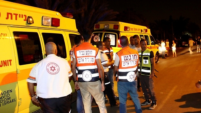 Magen David Adom teams at the murder scene (Photo: Avi Mualem)  (Photo: Avi Mualem)