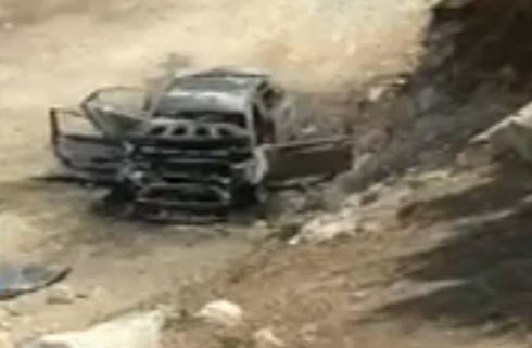 The burnt car found near Hebron.