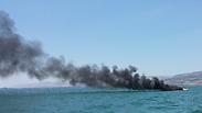 Boat ablaze Photo: Shalom Zohar