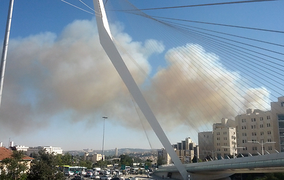 Smoke rising over downtown Jerusalem (Photo: Shai Melamed)