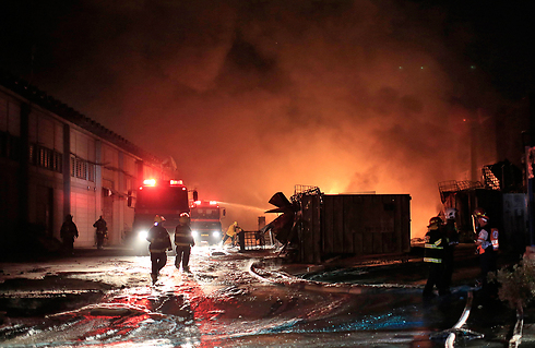 Sderot facotry caught fire after a hit by a rocket (Photo: AP)