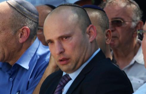 Economy Minister Naftali Bennett at Gil-Ad Shaer's memorial service (Photo: Motti Kimchi)
