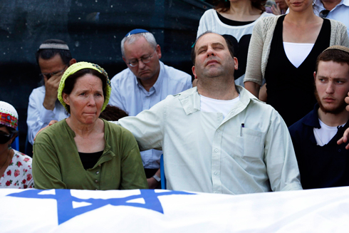 Rachel and Avi Frenkel, Naftali's parents, at the memorial service (Photo: Reuters)