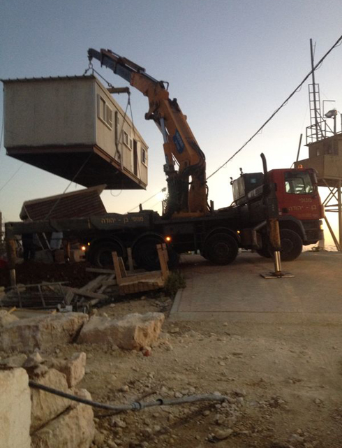 Trucks brought in Caravan style housing in the early morning. (Photo: Gush Etzion Regional Council) (Photo: Gush Etzion Regional Council)