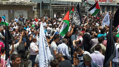 Slain Palestinian teen's funeral procession (Photo: Hassan Shaalan)