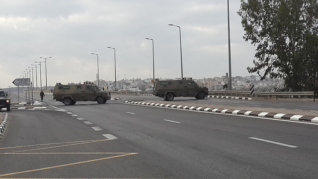 Military vehicles blocking Route 5614 toward Qalansawe (Photo: Hassan Shaalan)