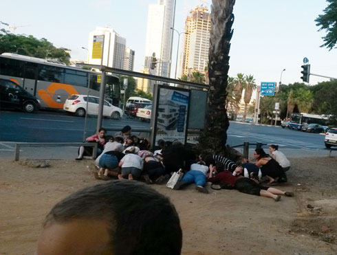 People duck for cover at Tel Aviv bus station (Photo: Maayan Simhoni)