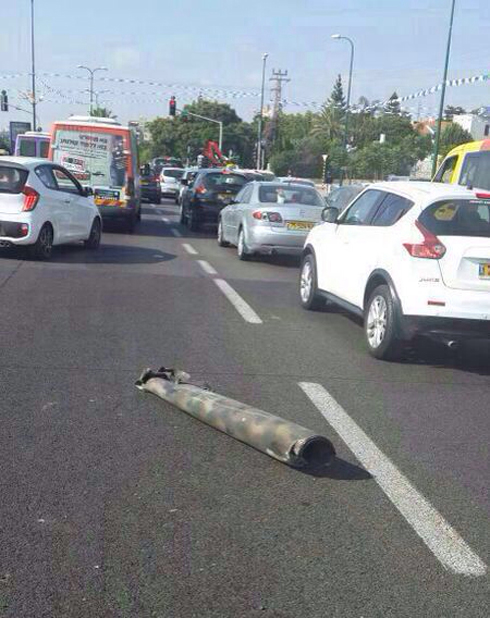 Rocket hits entrance to Ness Ziona (Photo: Barak Ben Avi)