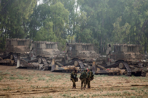 IDF troops and bulldozers after penetrating into Gaza. (Photo: AFP) (Photo: AFP)