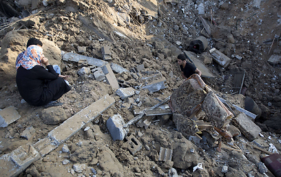 Woman sits in ruins of house in Gaza (Photo: AFP)