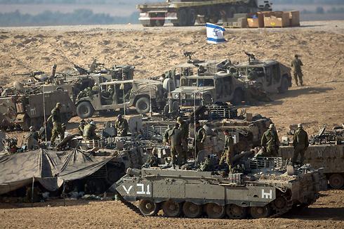 Israeli troops amassing on the Gaza border (Photo: AFP)