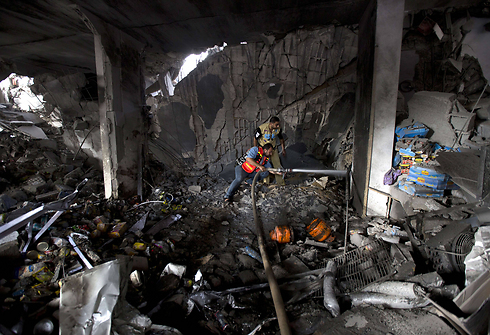 Gaza building in ruins after IAF strike (Photo: AFP)