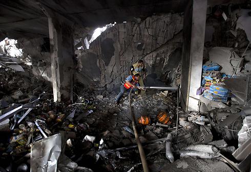 Gaza building in ruins after IAF strike (Photo: AFP)