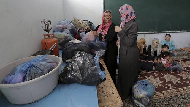 Palestinians taking shelter at UNRWA school (Photo: AP)