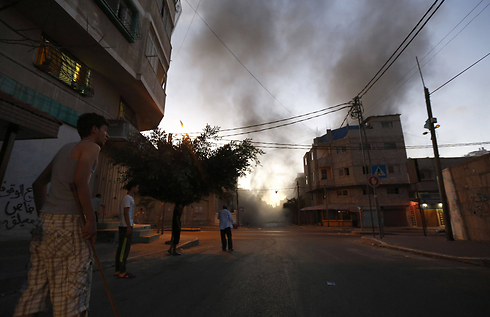 Smoke rises in a Gaza street after IDF air attack. (Photo: AFP) Photo: AFP