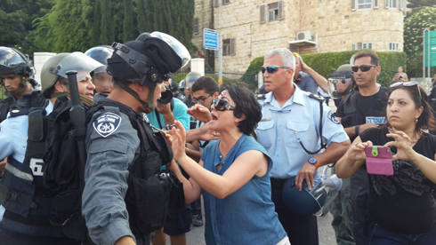 MK Zoabi faces off against riot police at a protest in Haifa. (Photo: Muhammed Shenawi) Photo: Muhammed Shenawi