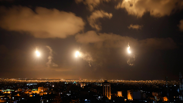Flares light up the Gaza sky (Photo: AP)