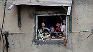 Palestinian family in house hit by IDF shelling Photo: AP
