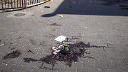 Blood stains left in UNRWA school yard after it was hit Photo: AFP
