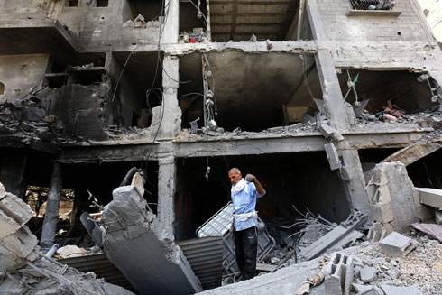 Taking in the damage in Gaza. (Photo: EPA) Photo: EPA